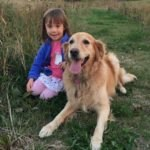 Golden Retriever and little girl